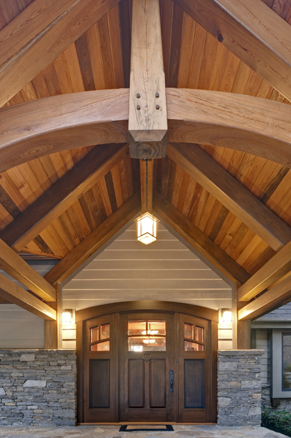 This LEED H timber frame home in North Carolina welcomes family and visitors through a reclaimed sinker cypress main entry porch.