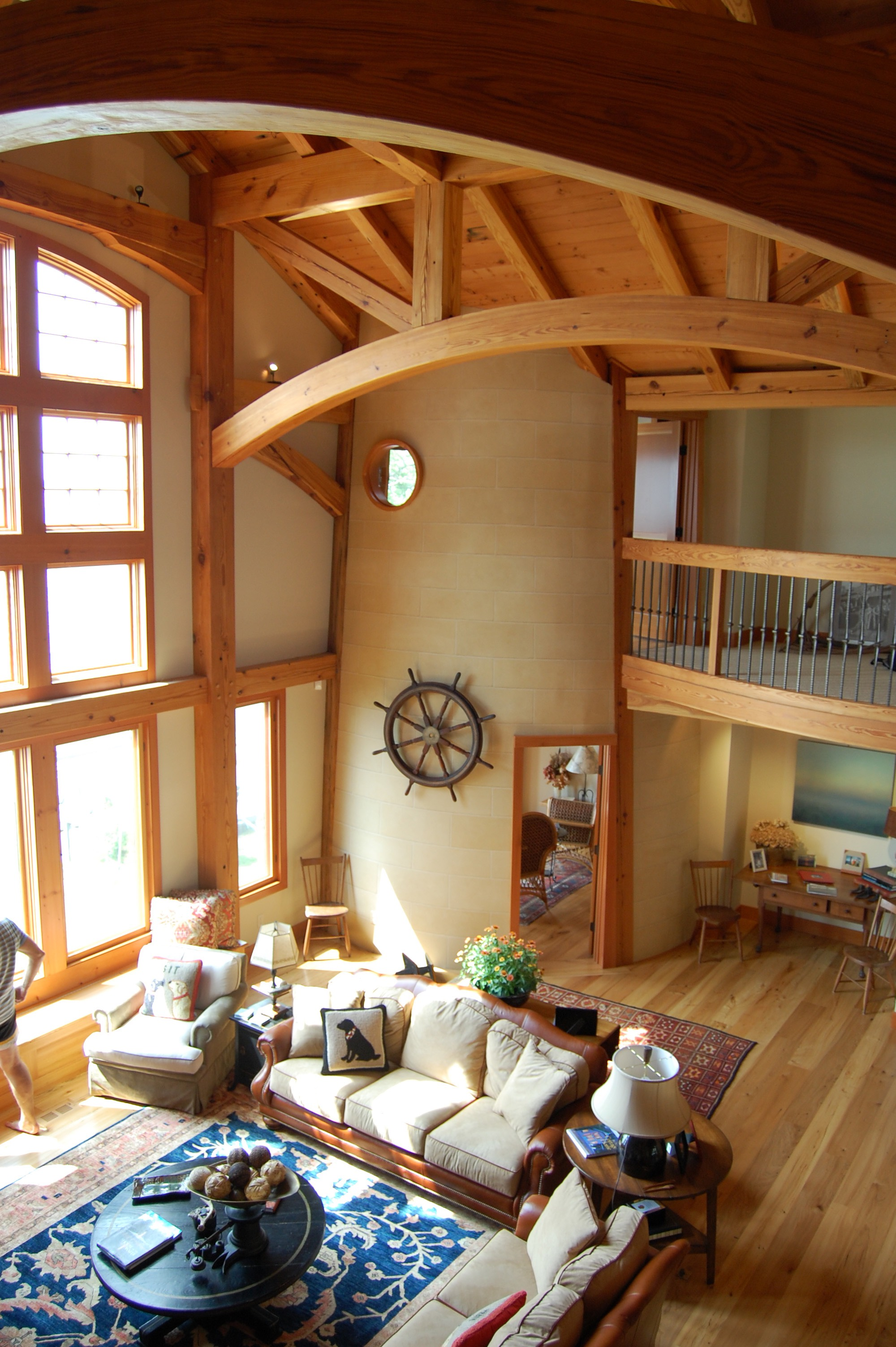 Within this timber frame home, a functioning, canted lighthouse constructed with Heart Pine timbers overlooks a large lake.