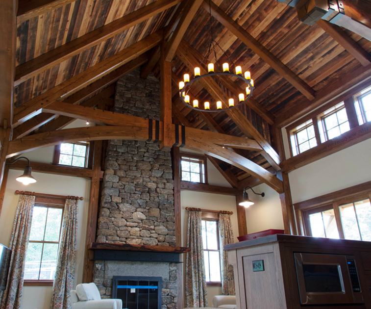 Reclaimed timbers and reclaimed mixed softwoods as ceiling t&g add great color (patina) and storied history to this New England home. To me, this project is perfectly topped off with hand hammered metal strapping on the trusses.