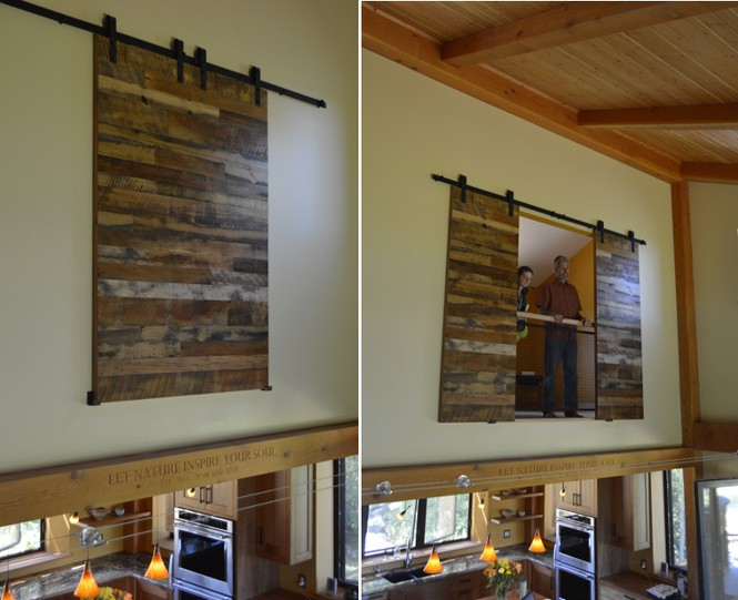 Tom and Ann's home uses reclaimed wood flat track doors as great room wall art and a privacy barrier to their upper level office.