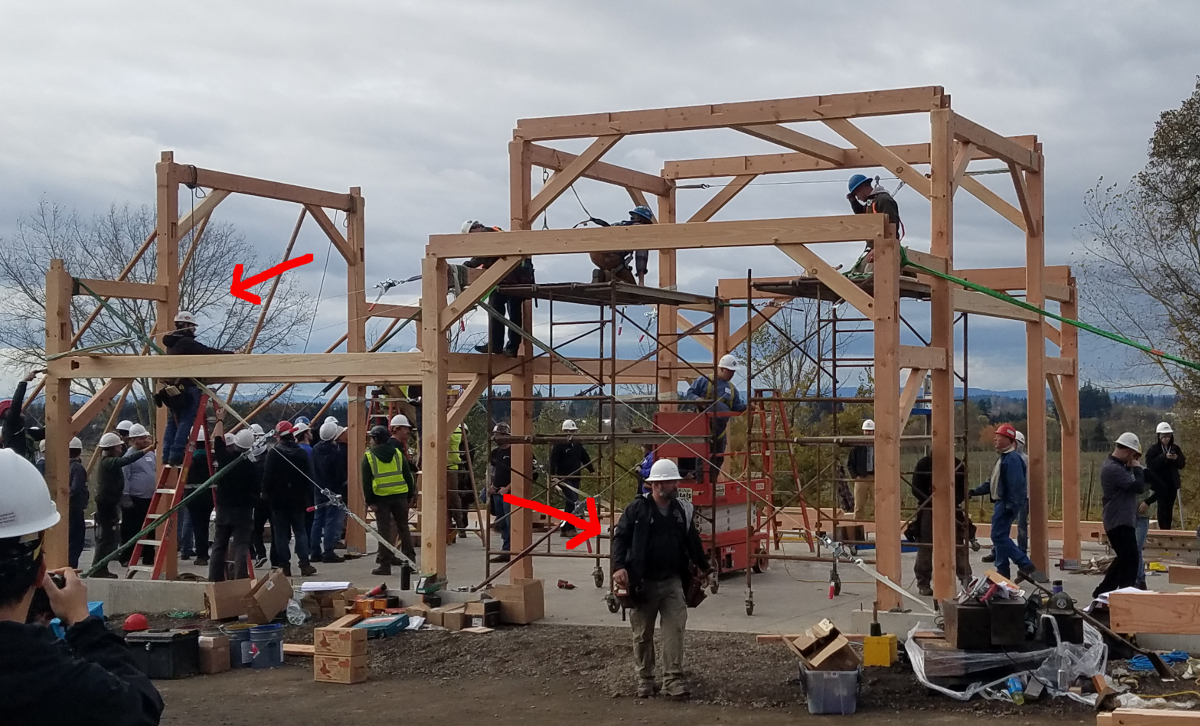 """Sean (left arrow), project lead timber frame engineer, and Darren (right arrow), project timber frame champion, worked together as """"Command Central"""" during the raising."""