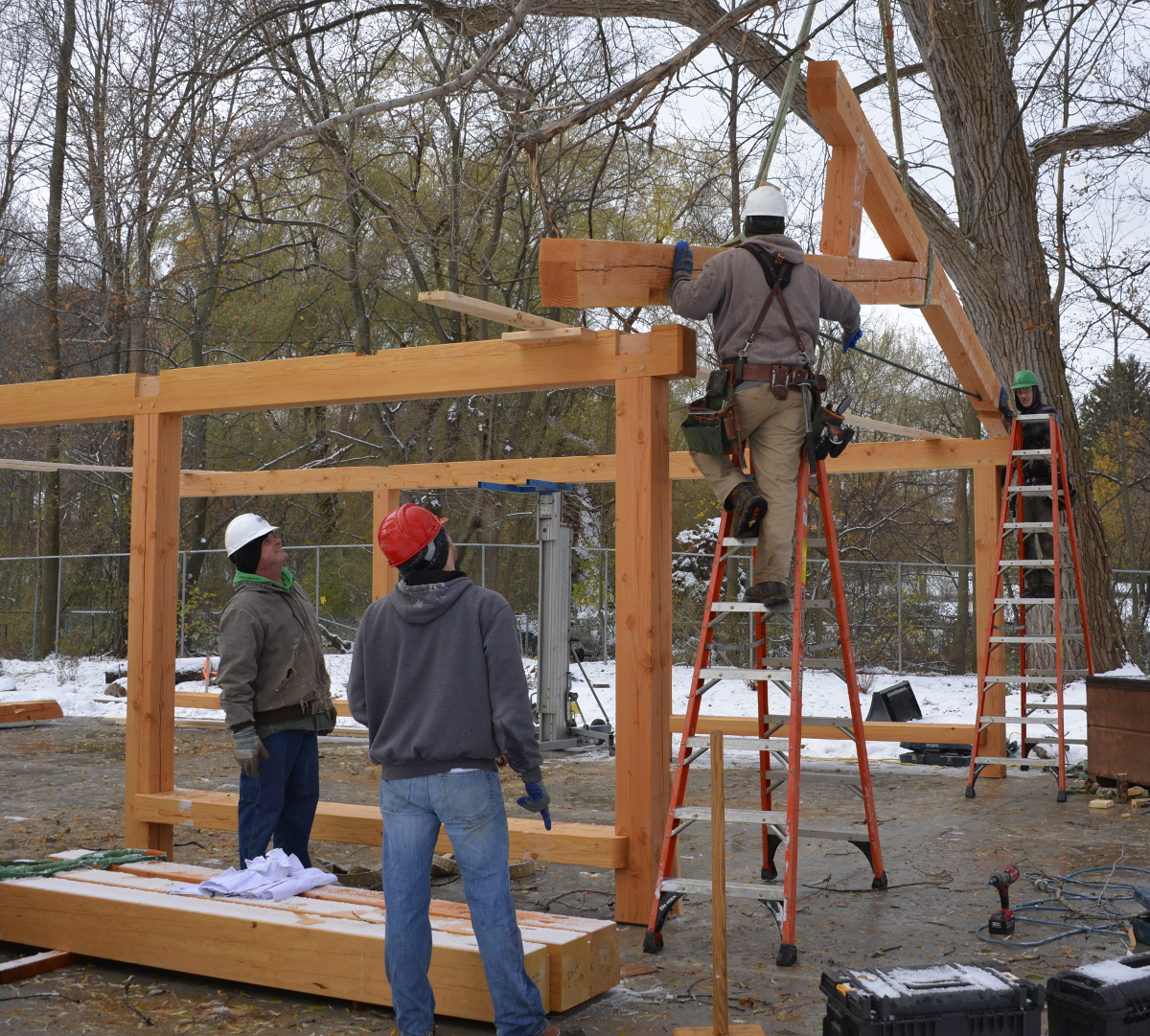 Setting the first truss for the pavilion roof.