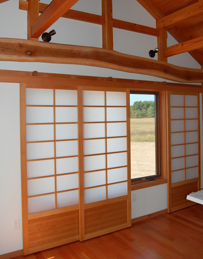 A plethora of styles and aesthetics can be met with flat track doors. Here shoji-inspired paper screen flat track doors provide privacy and ambiance in a master bedroom.