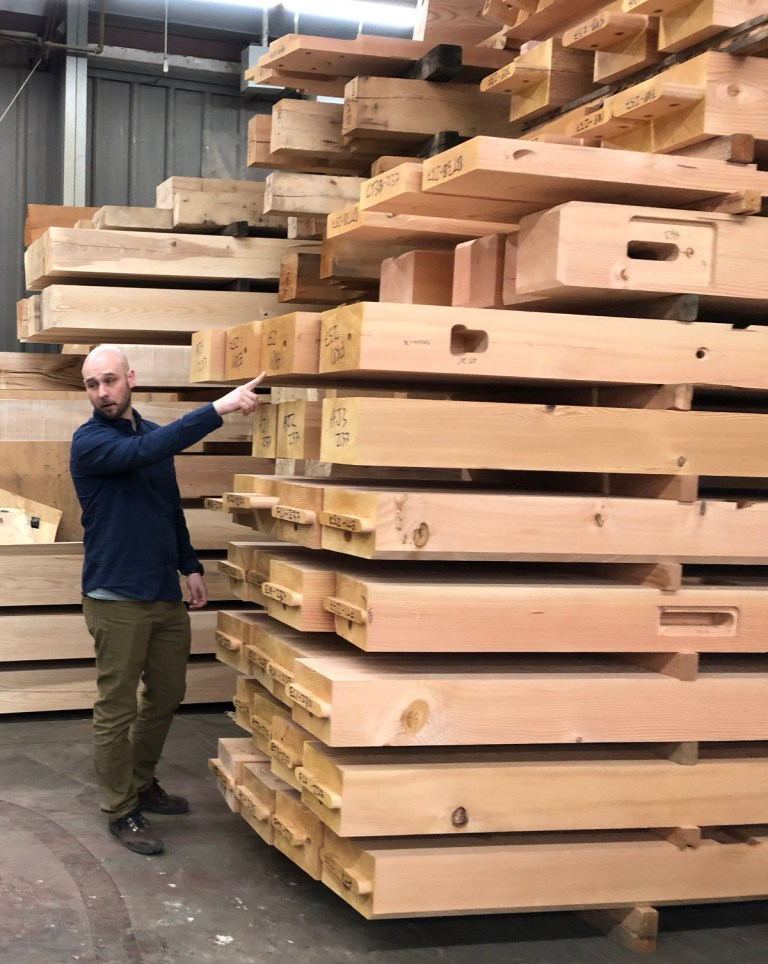 Like a big puzzle! A large stack of Douglas fir timbers for the LNB Farmington branch dwarf Bryan, project lead engineer, as he explains the end codes appearing on each stick.
