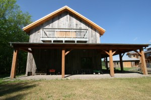 Adjacent to their family home, Dan and Beth's party barn is perfect for gatherings, pick-up basketball, jam sessions, and of course, storage.