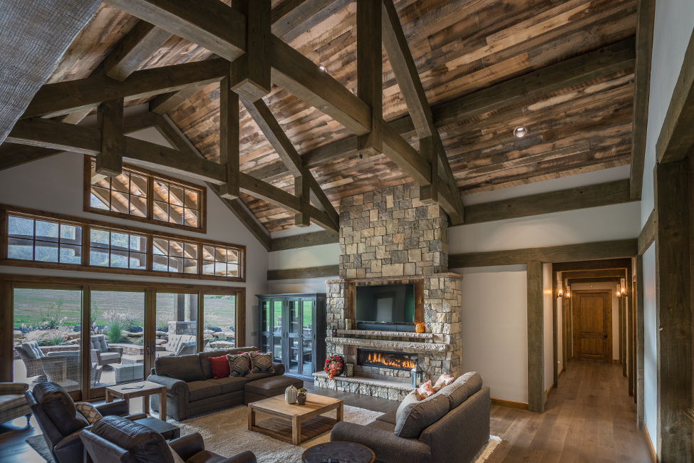 Douglas fir timbers with a multi-step finish deepened the surface of the timbers to create a rich patina reminiscent of aged and well-loved structures in the Allegheny Forest where this home is located. Photo: Scott Hemenway