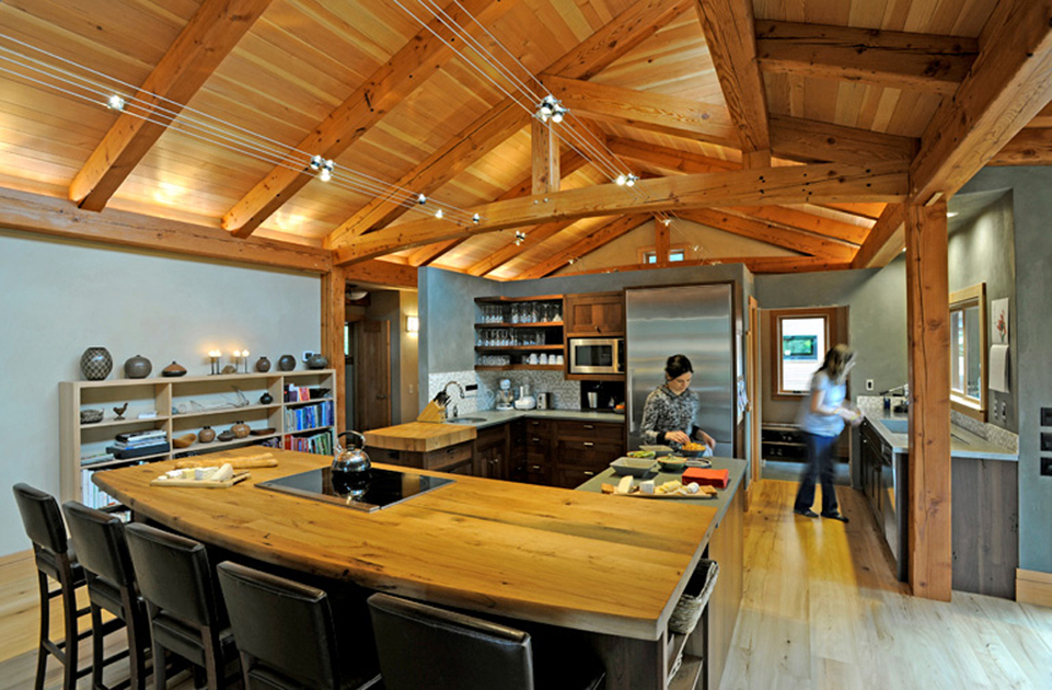 How cool is this house in Oregon that was built with reclaimed timbers?! (And that's Jennifer in the kitchen.)